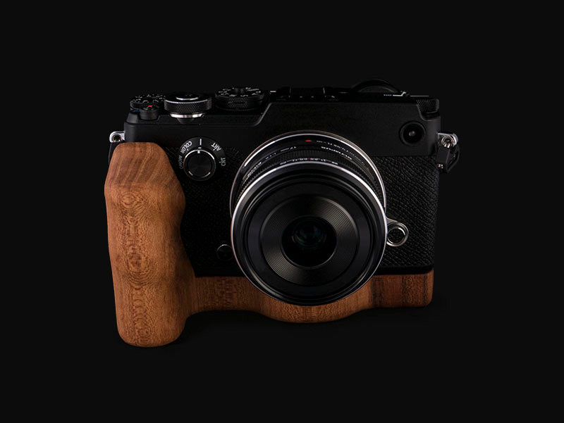Olympus PEN F with a Holzgriff