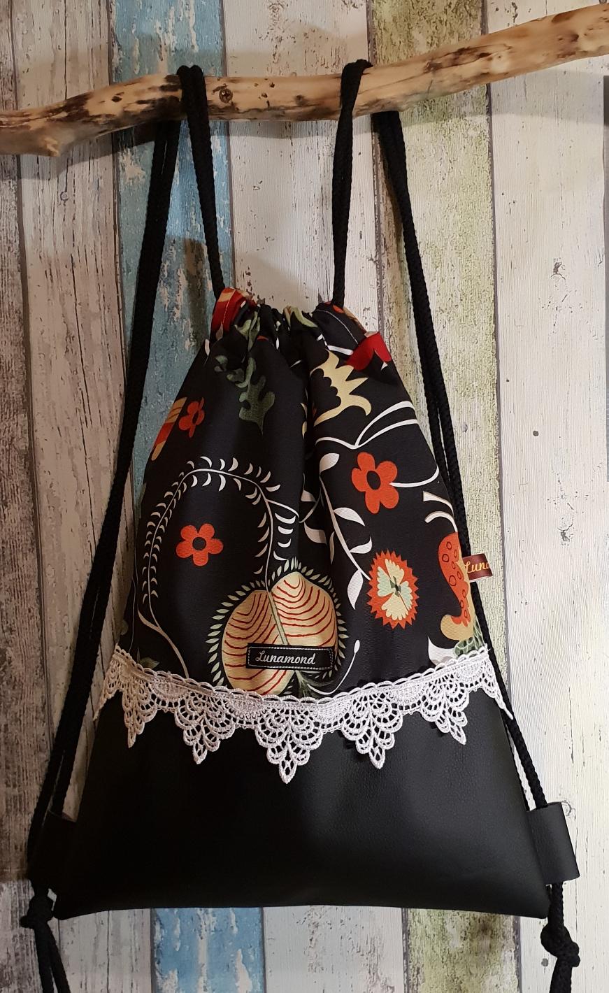Blumen schwarz/Leder schwarz