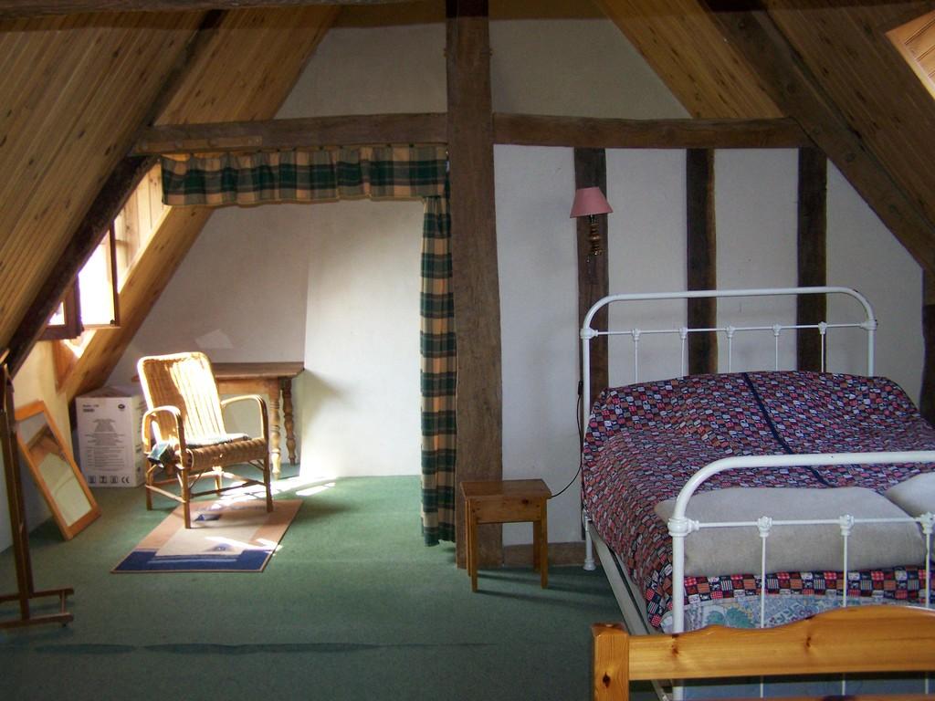 chambre à 3 lits à l'étage