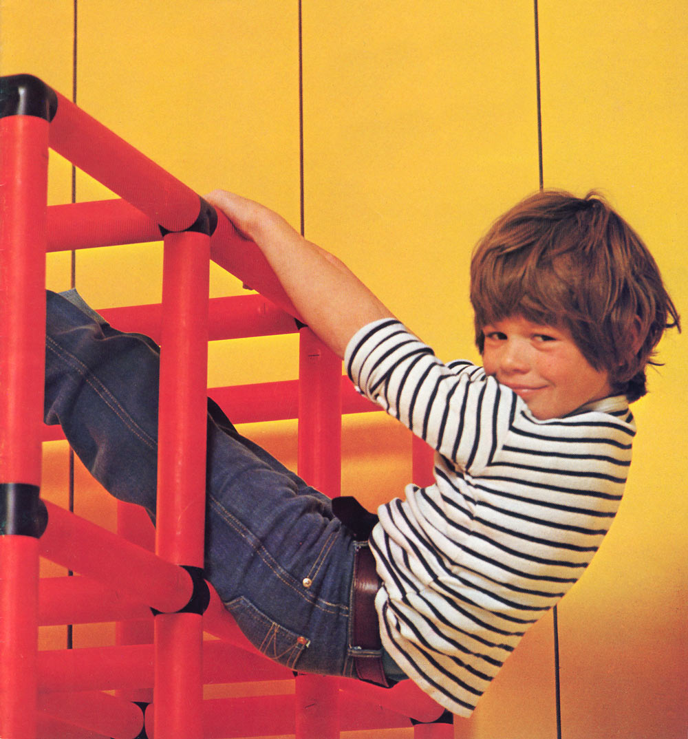 Boy hanging from QUADRO jungle gym