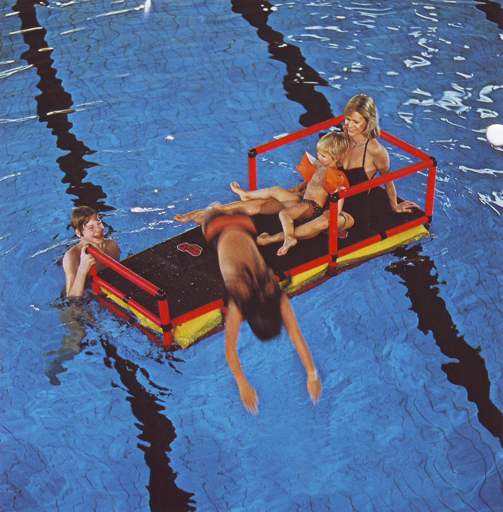 Family floating on QUADRO in a public pool