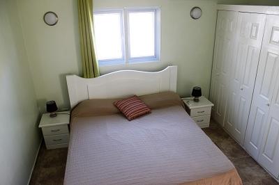 Schlafzimmer-1-Urlaub-Curacao-Ferienhaus-Karibik-Villapark-Fontein