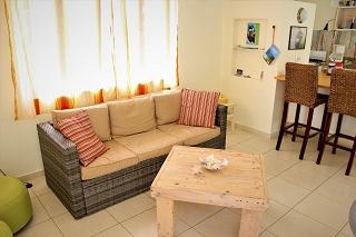 Wohnzimmer-Ferienhaus-CAS-IGUANA-Urlaub-Curacao-Karibik-Villapark-Fontein