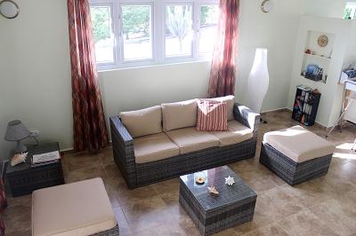 Wohnzimmer-Urlaub-Curacao-Ferienhaus-Karibik-Villapark-Fontein
