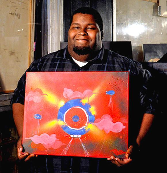 Joseph Walker holding blimp painting