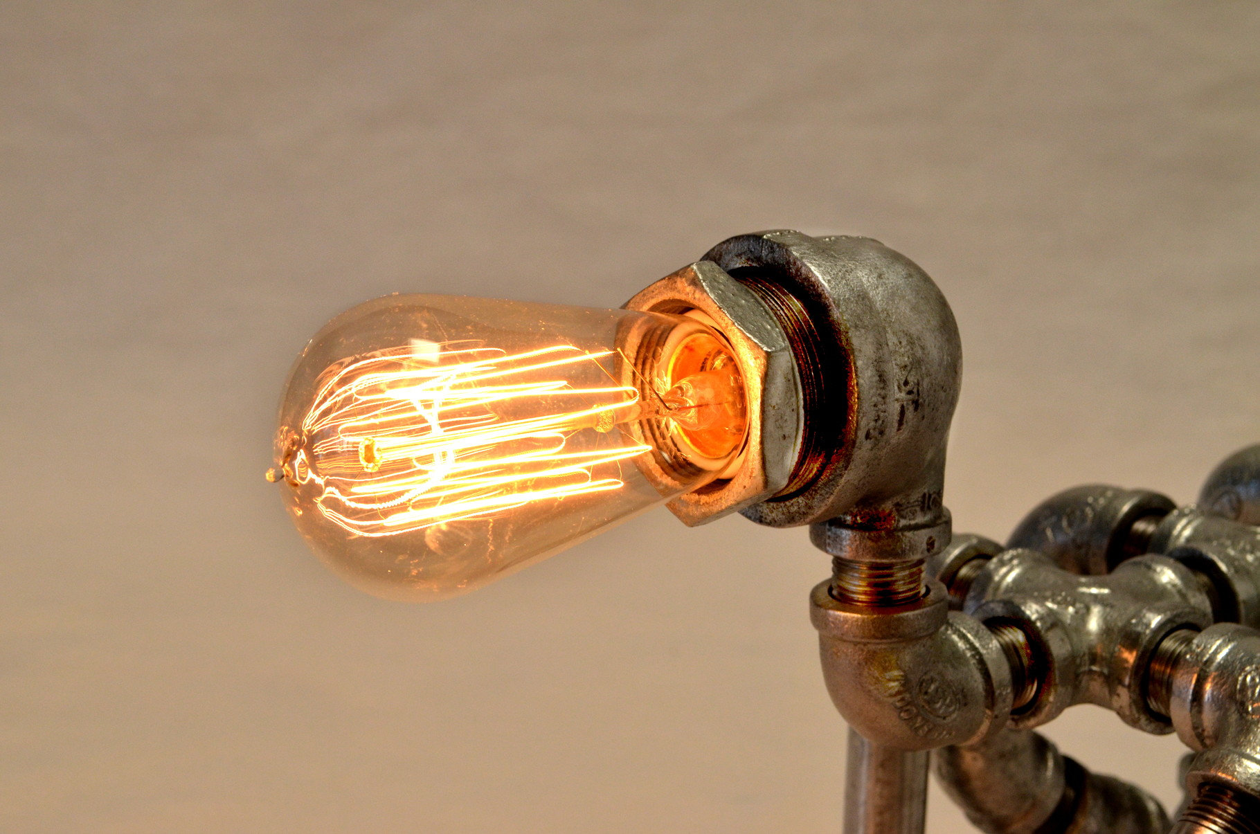 Critter's vintage-inspired 40 watt, hand wound bulb adds a warm glow to any room.