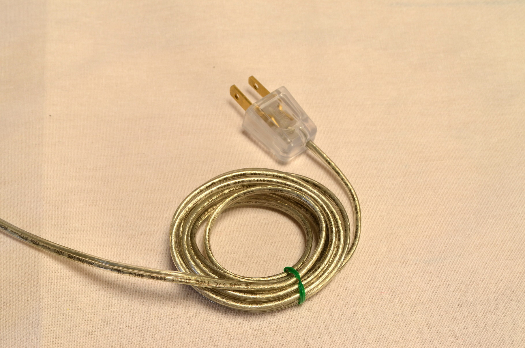 SIM's 8' clear industrial cord with clear contemporary plug.