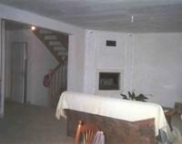 Maison entièrement en béton cellulaire, finition intérieure plâtre traditionnel. Habillage cheminée également en béton cellulaire (posée à 45°)