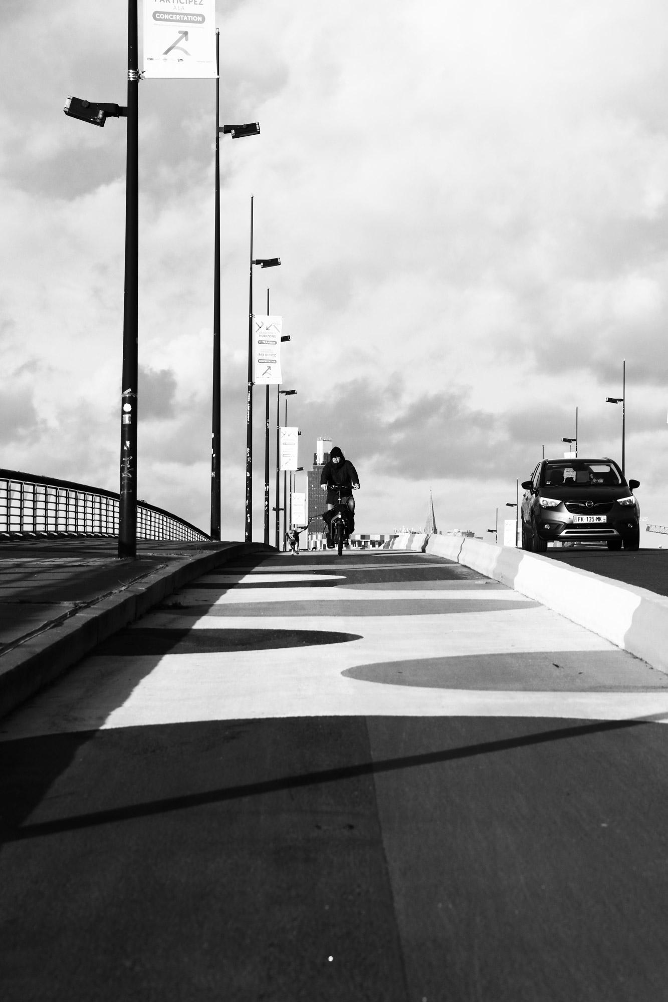"""""""Rider with a dog"""" -  Pont des 3 Continents, Nantes-Rezé. ©Clémence Rougetet"""