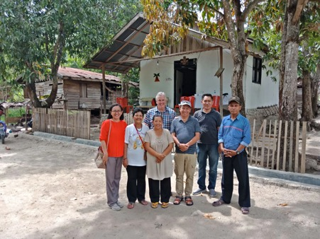Henny, Richard, Jim and locals in front of a church