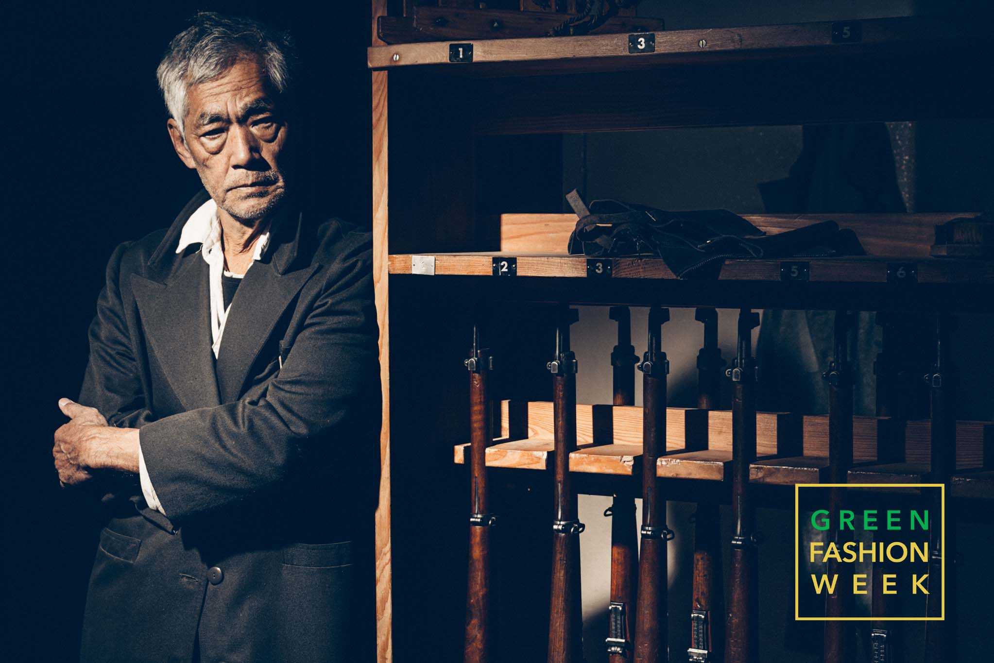 Hollywoodian actor Hal Yamanouchi poses next to Museum's World War II guns. Photo Credit: Vittorio La Fata | www.vittoriolafata.it
