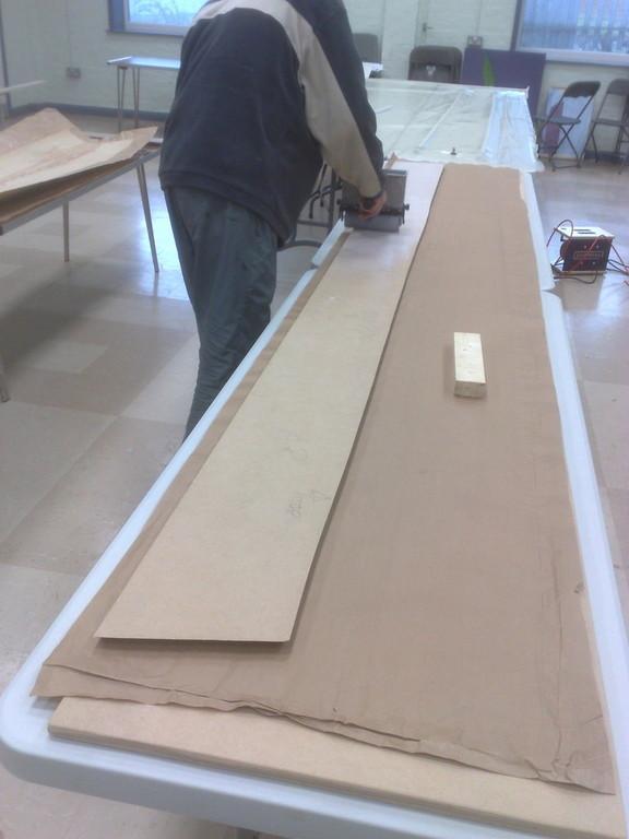 cloaking panel being veneered