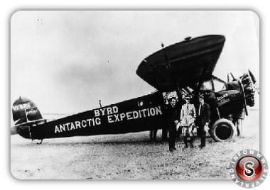 Harold June, Commander Byrd, and Bernt Balchen, in front of the Fairchild airplane, Stars and Stripes.
