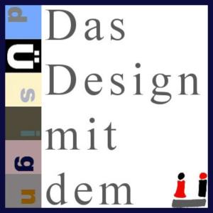 Banner mit hochkantem dÜsign-Logo und dem Schriftzug: Das Design mit dem Ü (als Logo).