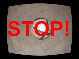 Dieses Bild von Thorsten Hülsberg zeigt einen Fußball im TV-Design und darüber steht in rot: STOP!