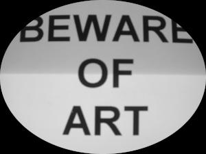 Dieses Bild von Thorsten Hülsberg zeigt einen ellipsenförmige Ausschnitt auf schwarzem Grund wo man in Grautönen lesen kann: BEWARE OF ART.