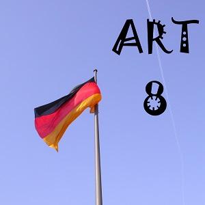 Dieses Bild von Thorsten Hülsberg zeigt eine Deutschlandfahne vor blauem Himmel und daneben in schwarzen ans Virus erinnernden Buchstaben ART 8.