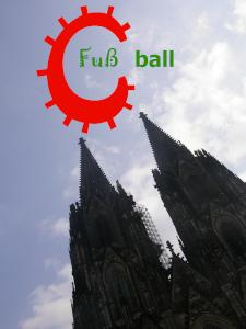 Diese Fotocollage von Thorsten Hülsberg zeigt, wie ein rotes C in Form eines Virus einen Teil des Wortes Fußball in BALLackergrün über dem Kölner Dom schon infiziert hat.