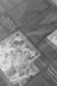 Dieses Foto von Thorsten Hülsberg zeigt eine verschwommene Zeitungsseite in schwarzweiß.