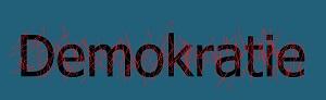 Das Bild zeigt das Wort Demokratie welches rot übermalt wurde.