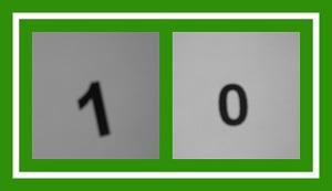 Dieses Bild von Thorsten Hülsberg zeigt in einem angedeuteten Spielfeld in den Farben von Der BALLacker die Ziffern 1 und 0.