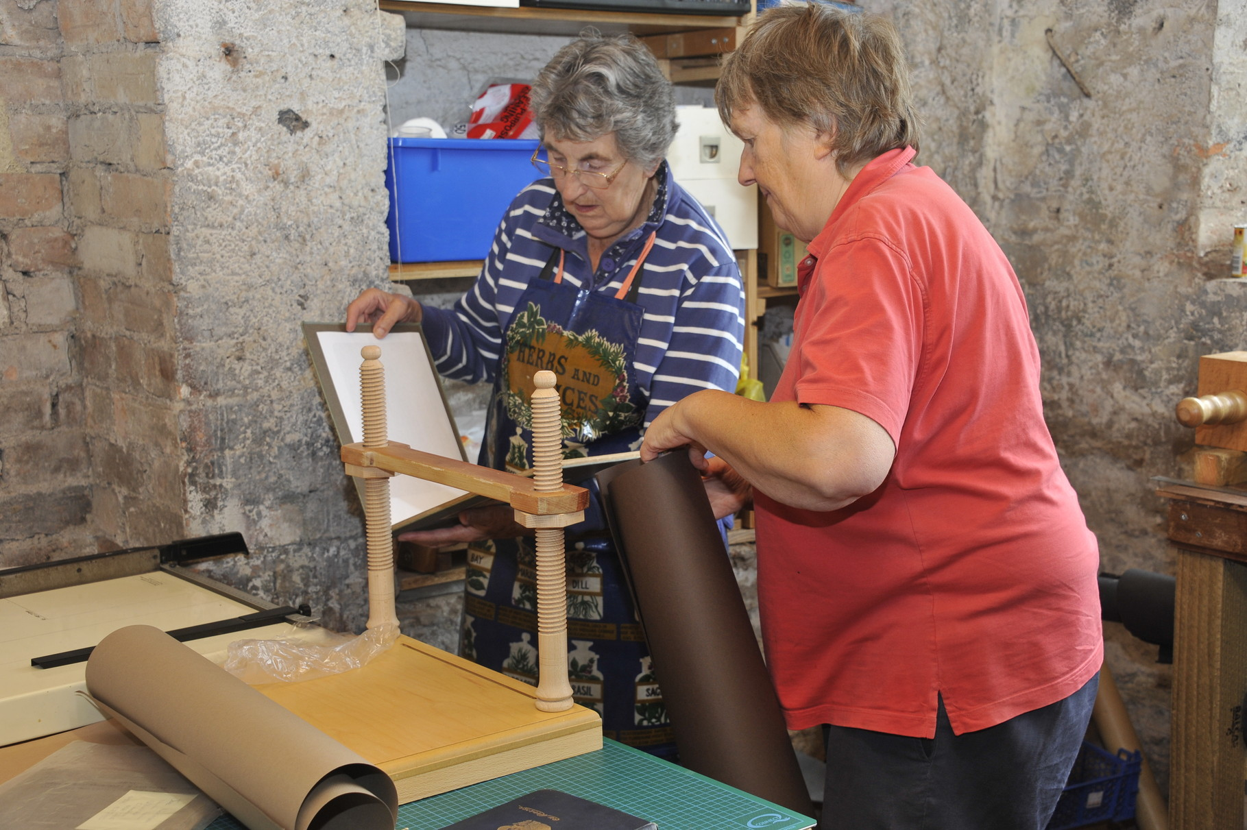 Members of the bookbinding team lovingly restore worse-for-wear books at our very own bindery...