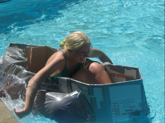 "A cardboard ""boat"" we made with my campers - floating well!"