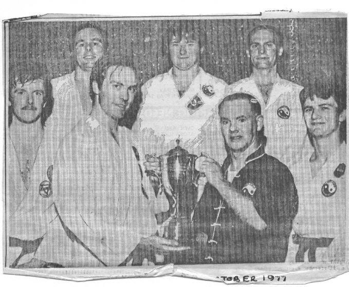 Keith Alker being presented a trophy by Derek Gordon in 1977