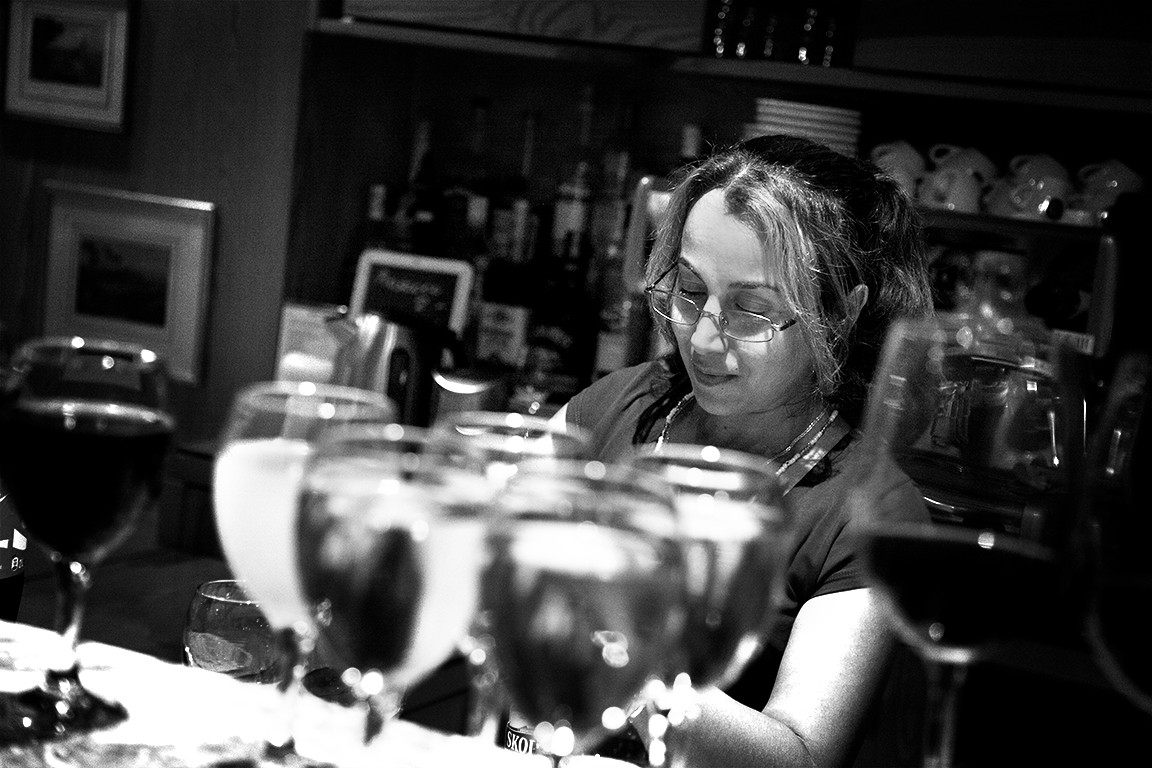 Aziza Butic, receptonist, filling glasses for the guests