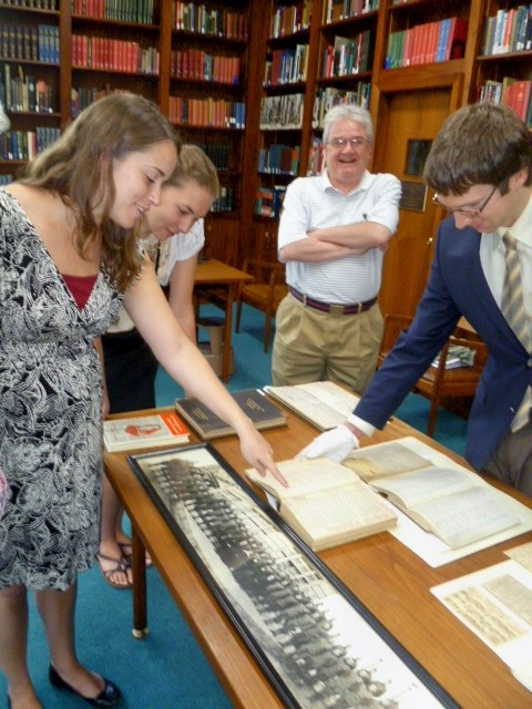Jeff Kozak, Assistant Librarian, is showing orginal documents from George Marshall's life.