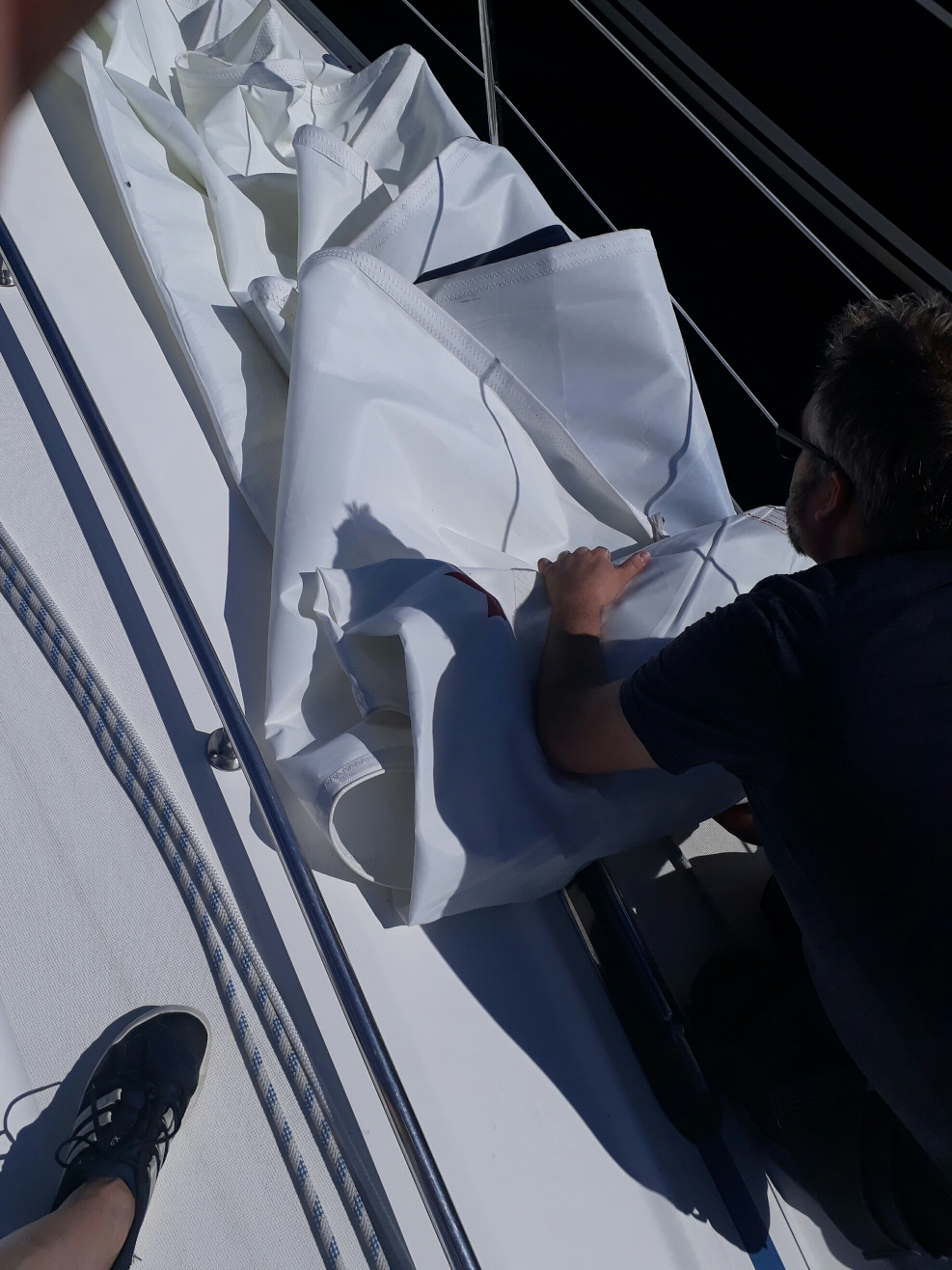 Folding up the sail for repair