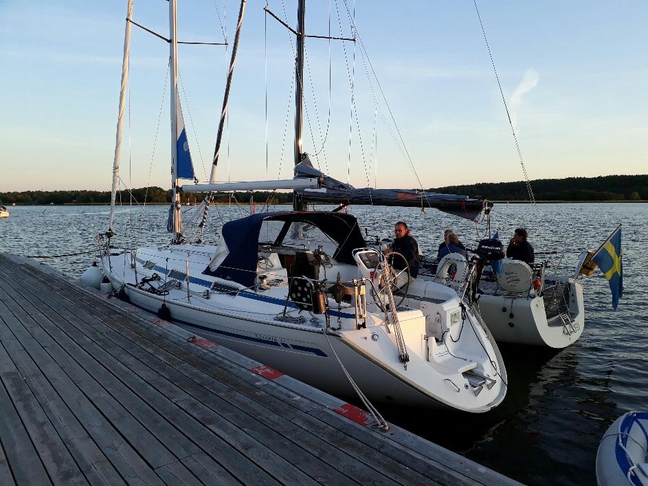 Us at pier and regatta boat longside