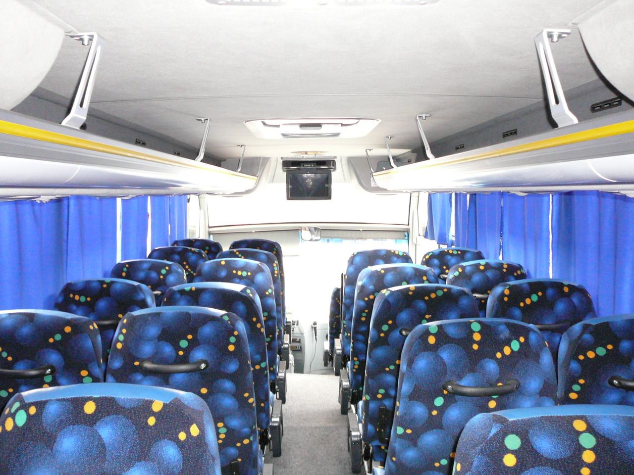 Так как автобус небольшой, телевизор всего один
