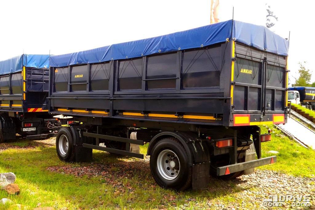 Вместимость кузова прицепа 25 м.куб, грузоподъемность 15 000 кг, разгрузка на три стороны
