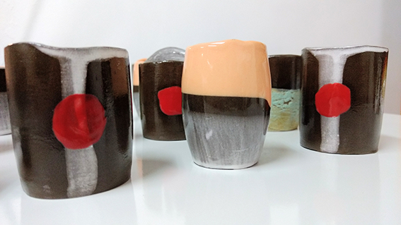 Unique handbuilt Espresso cups in black earthenware. Coloured with engobes and non-toxic glazings.