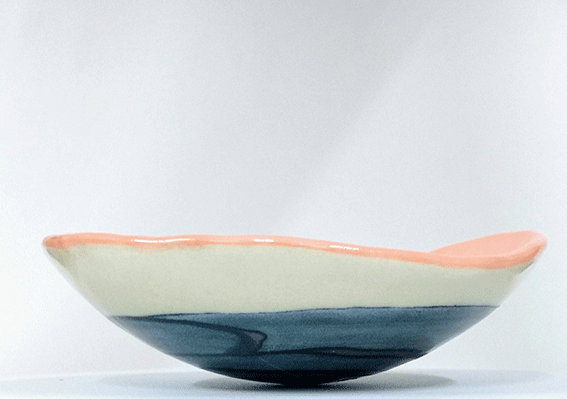 "This unique bowl/plate is slab built in ""Jasmin"" earthenware. The native colour of the material is a gentle creamy white. It is coloured inside with soft orange underglaze and at the bottom, with several layers of underglazes and glazes."