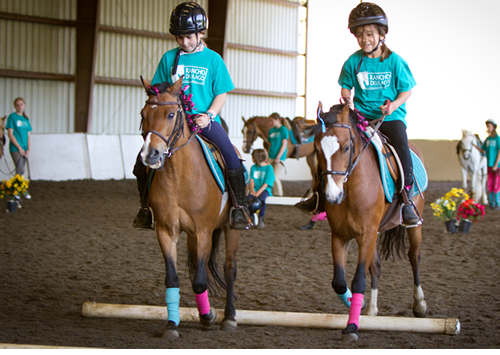 Campers showing off what they learned our Friday afternoon horse show for family and friends