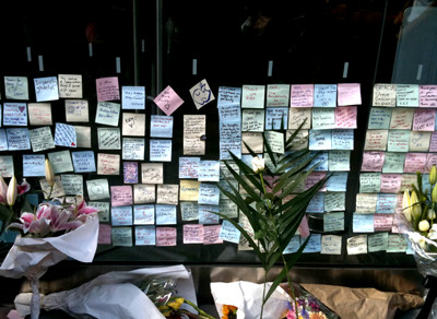 many messages and flowers on the apple store's wall