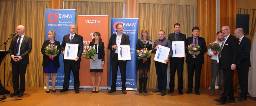 Die Nominierten bei der Auszeichnung. R. Junold (BVMW), Fam. Behn, S. Smolinski u. Th. Tweer, M. Jugert u. U. Schmidt, E. Wussow u. Dr. M. Bartels, J. Wallochny, W. Röpert BVMW), Minister Ch. Pegel, (v.l.), Foto: D.Kressin
