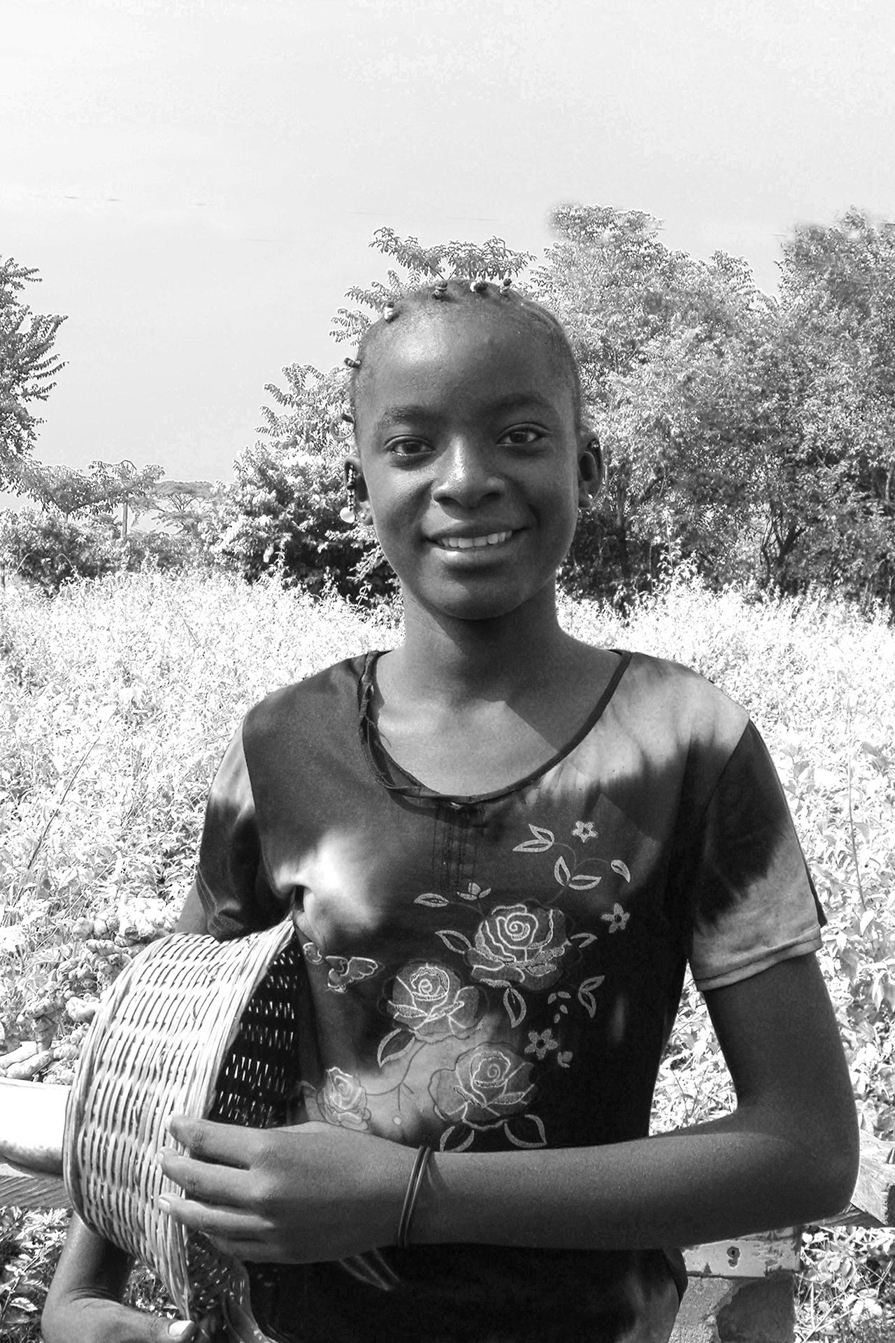 Sourire, gentil sourire 3. 2007, Sur la route d'ABENGOUROU, Côte d'Ivoire