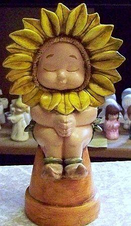 Sonnenblumenkind auf Topf