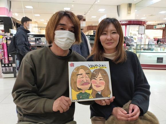 岩手県のさくら野百貨店・北上店で似顔絵を描いた夫婦