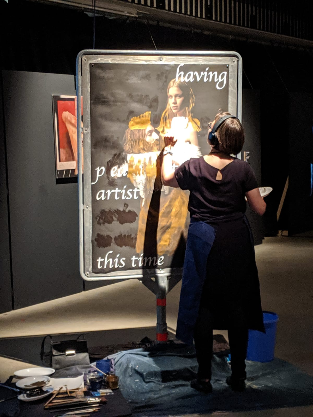 "Marianne Iten Thürig ""destroying"" the poster Salome II of the artist Denys Shantar."