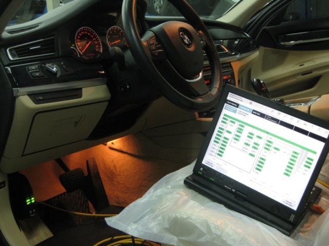 Diagnosis of a BMW car with a laptop and special diagnostic equipment