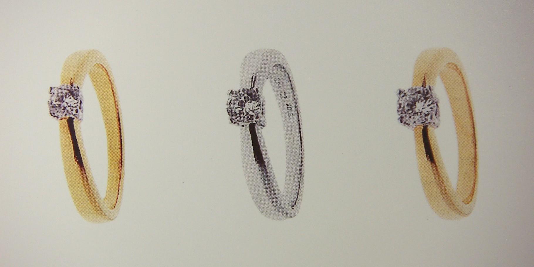 Ring, Gelb- und Weissgold 750, mit 4-Griff-Fassung