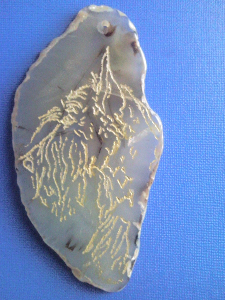 Pendant - hand engraving with gilding on natural agate slice, January 2013