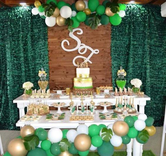 mesa de dulces verde para baby shower