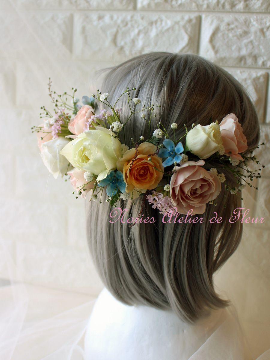 白、オレンジ、ピンクなどの生花のパーツタイプのヘアオーナメント