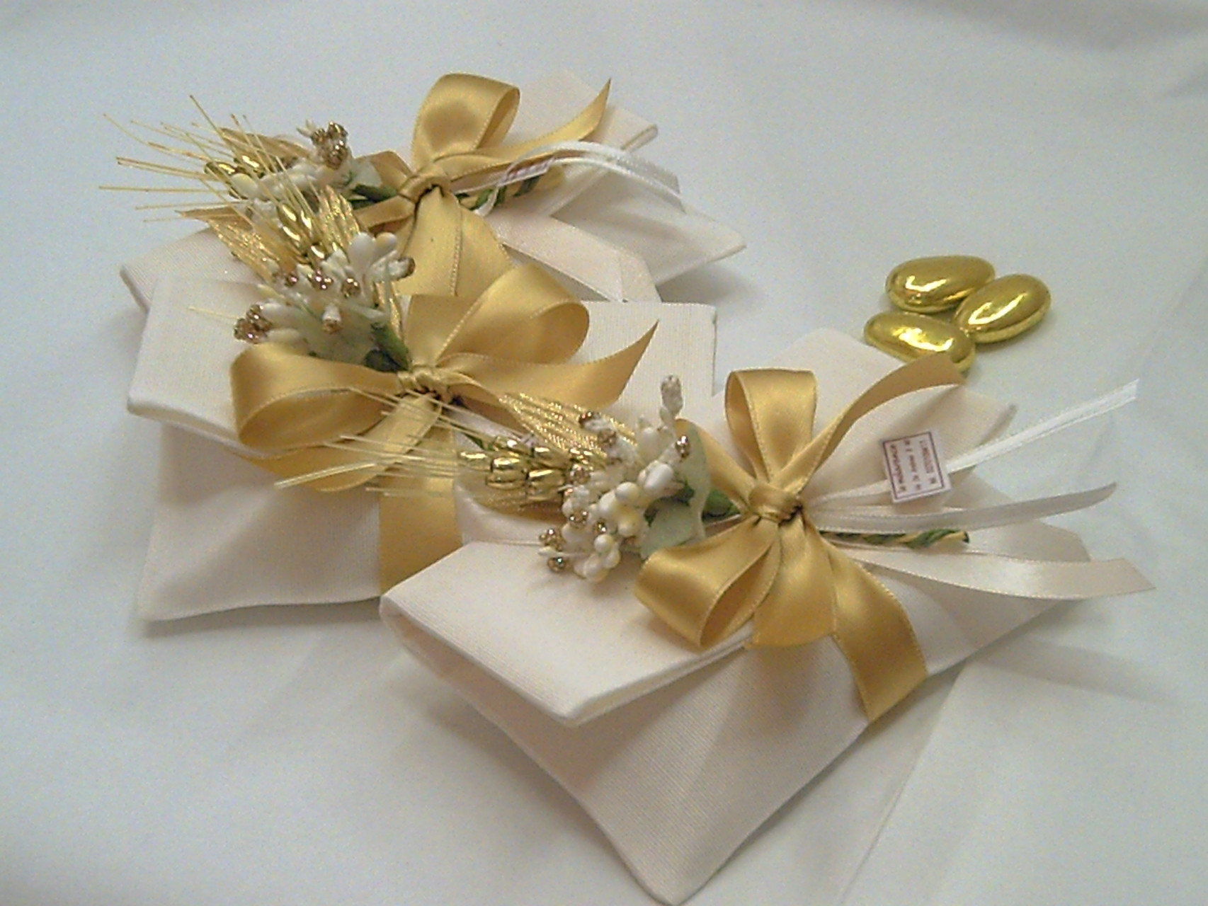 Bustine in tessuto con decoro per nozze d'oro