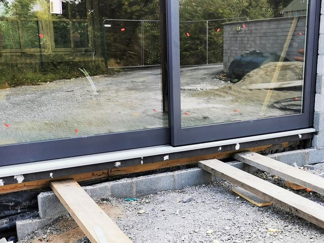 The Detail: The 180mm deep Triotherm has been bonded and mechanically fixed to the edge of the concrete floor. No additional structural support is required.